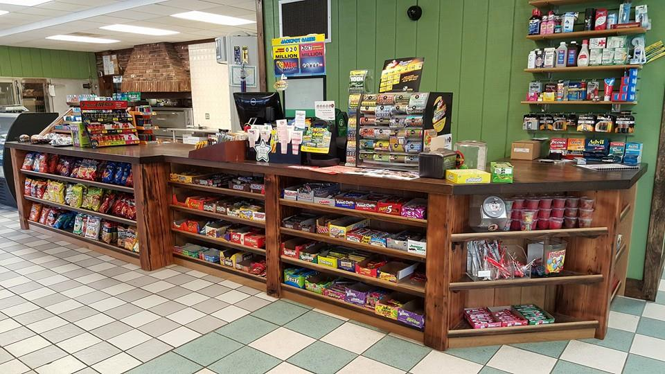 Custom made wood checkout counter with shelves for snacks