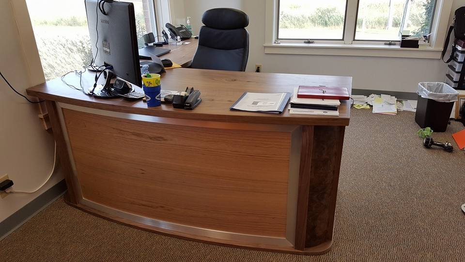 Office desk with curved front