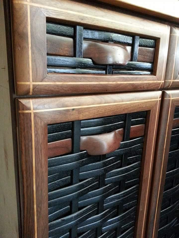 Closeup of door and drawer with oven wood design