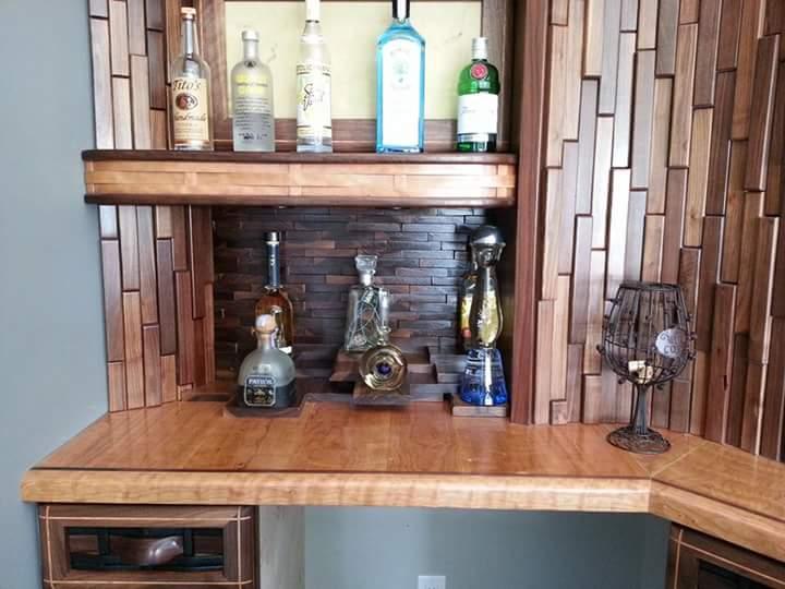 Custom wet bar with textured wood inlays