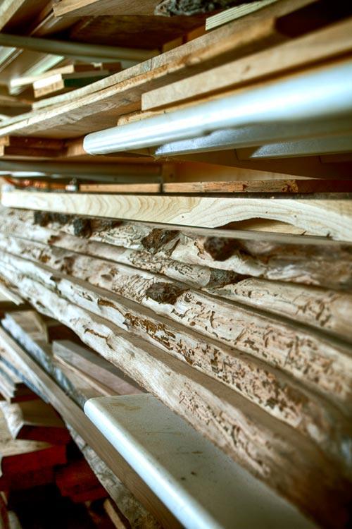 Stacks of wood on shelves in workshop