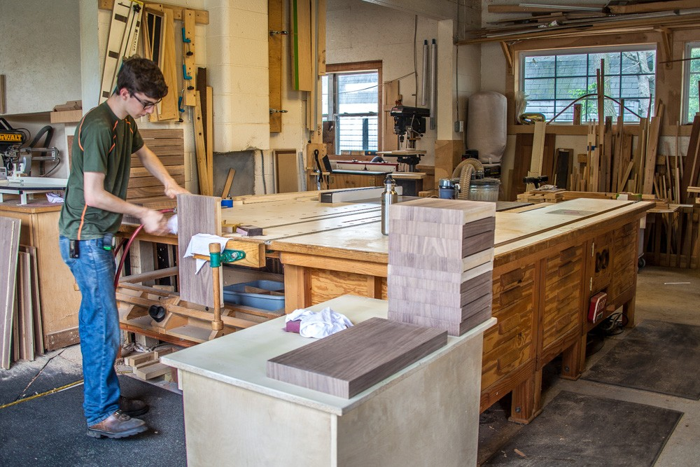 Woodworker apprentice working at a table