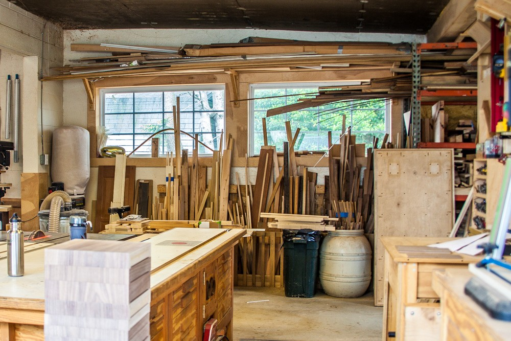 Workshop with bins of assorted pieces of wood