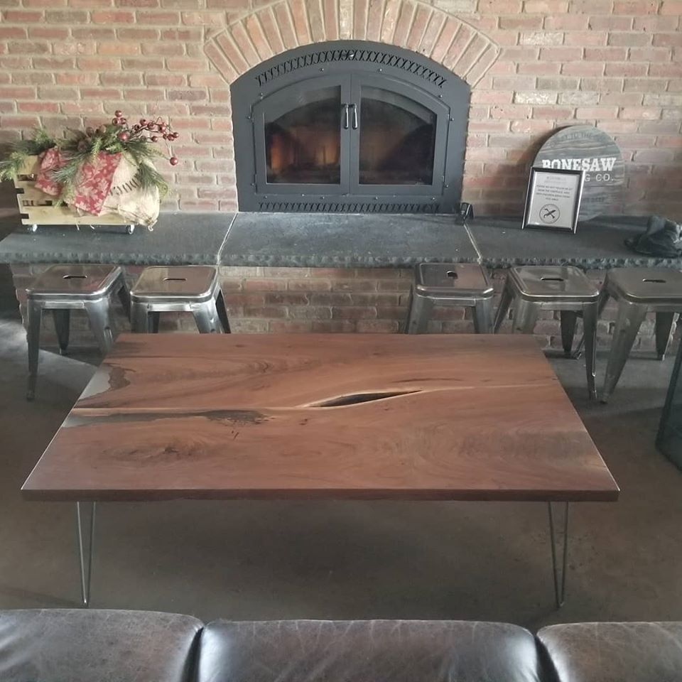 Bonesaw-Brewing table in front of fireplace